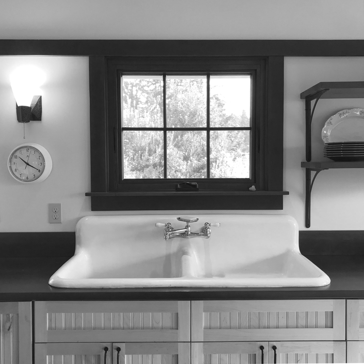Farmer sink, fir counters, and bead board wood cabinets in a Vashon Island cabin.
